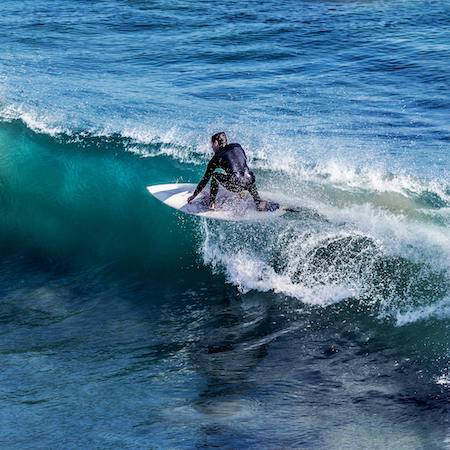 Surfer on the top of a wave