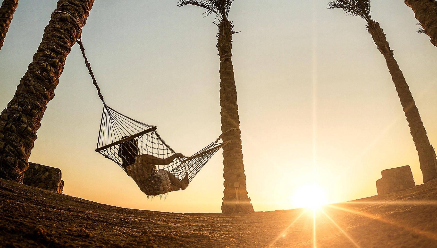 Woman in hammock watching the sun