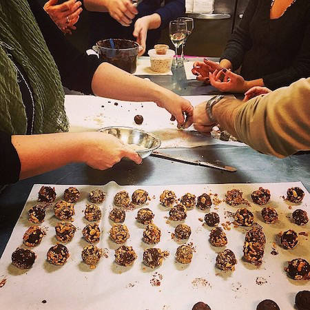 People hand making truffles