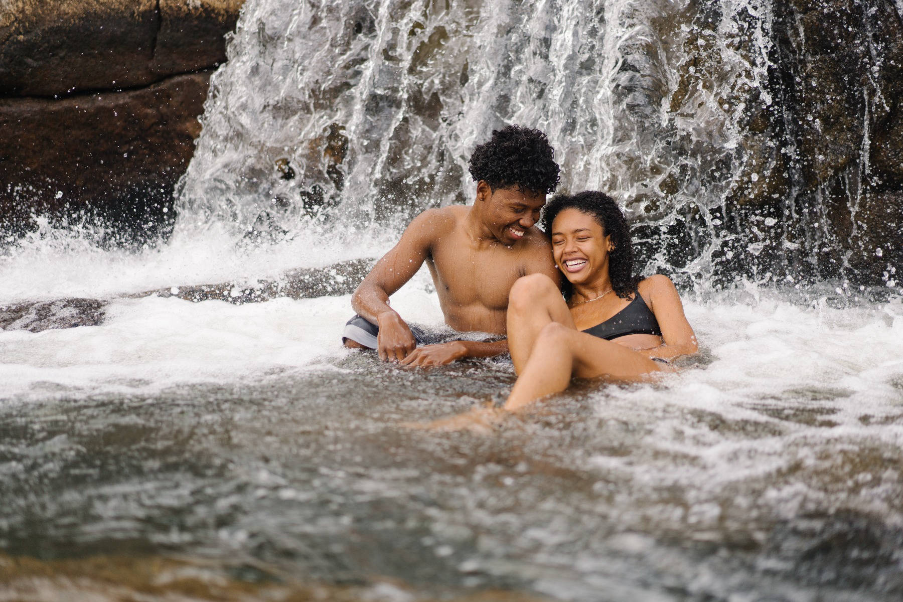 Couple in a waterfall in Thailand