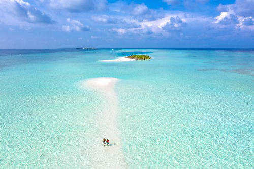 Couple walking on beautiful island
