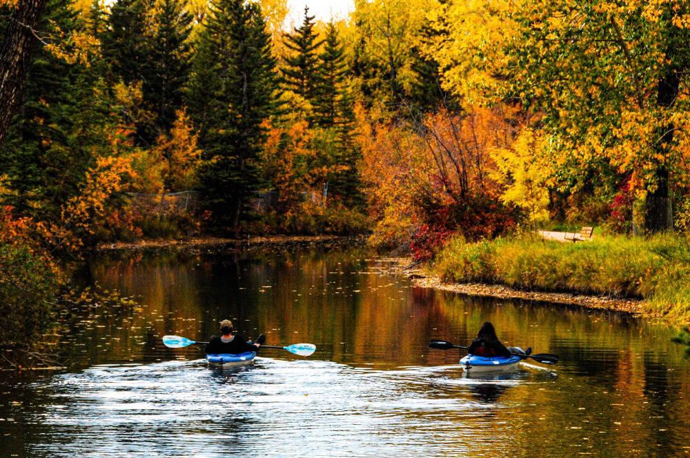 People kayaking on Autumn lake