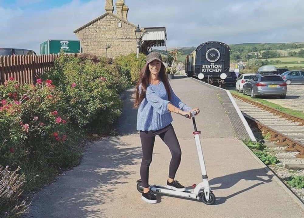 Woman on INOKIM Mini 2 Electric Scooter