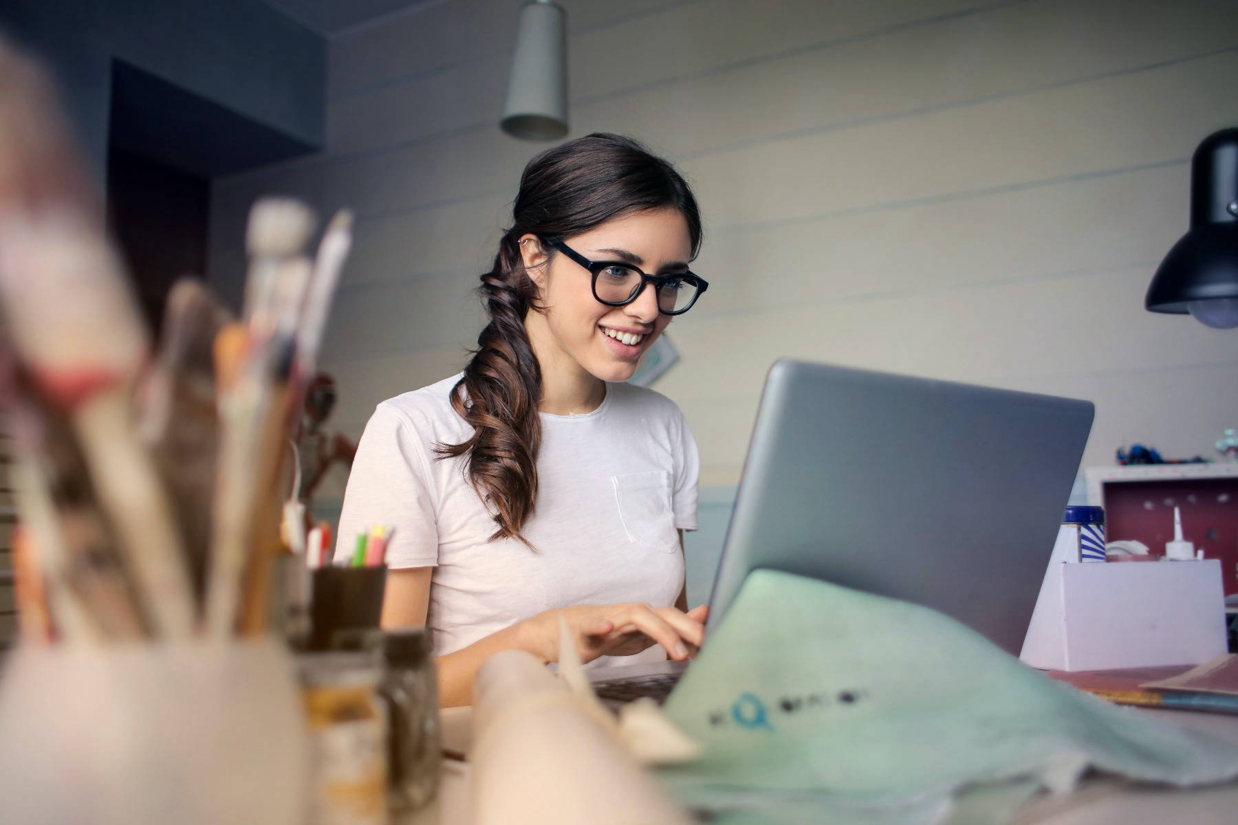 Woman studying online via laptop