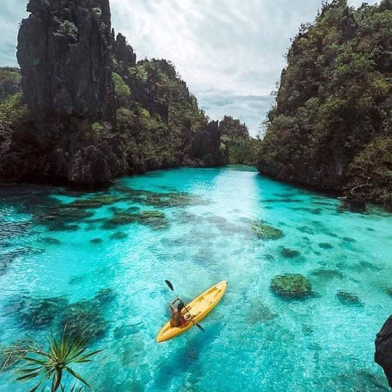 Canoe in blue water lagoons