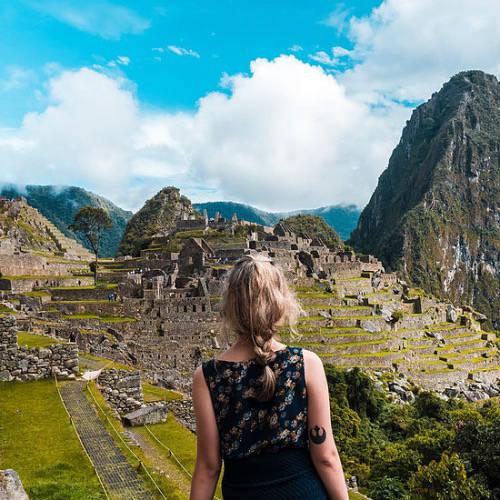 Woman looking at Machu Piccu