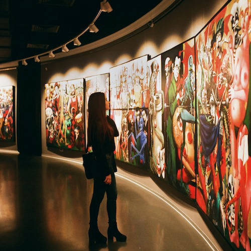 Woman viewing art in a gallery