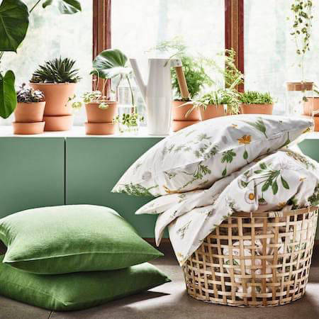 Bright living room with green floral linens